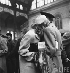 Alfred Eisenstaedt: Couple in Penn Station sharing farewell embrace before he ships off to war during WWII, 1943