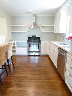 "the ""after"" kitchen from our 4th renovation, with penny tile, floating shelves and more!"