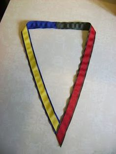 Tutorial to make a ribbon necklace for all of those Mom's pins in Cub/Boy Scouts. Would work just as well for Girl Scouts (who also have similar pins, when purchased!) or AHG, just switch out the colors.
