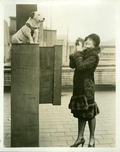 Silent film actress and dog.