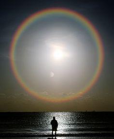 rainbow ring around the sun & moon