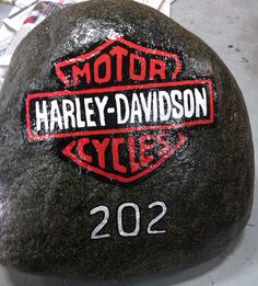 For a friend who loves Harley Davidson, to put by his mailbox! Harley Davidson hand painted rock.