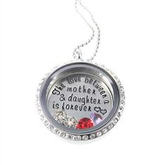 I want!!! The Love Between a Mother and Daughter is Forever / LIving Locket / Personalized Hand Stamped Jewelry / Floating Locket by Silver Impressions