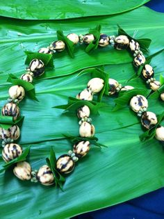 Kukui nut and ti leaf lei