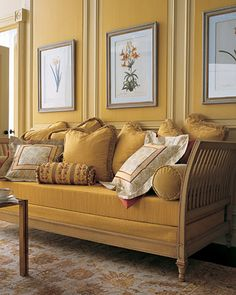 Dark Yellow  On this daybed, opulent fabrics and a rich palette of burnt red, deep gold, and pale cream and gold create a sense of depth.