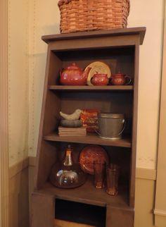 Slant back cupboard