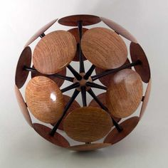 Woodturning by Wayne Hall I have had a similar idea. I think I would like to try filling in the gaps with smaller circles or other geometric shapes. Also, I think I would like to stain or paint the underside of the outer discs so that the interior is more visible, i.e. provide a better contrast between outer surface and the interior.