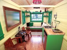 Putting the loft over the bathroom & closet up front leaves the whole back open, spacious, light, and airy.  By Meg Caswell, winner of Design Star (season 6.) #tinyhouse #smallspaces #floorplan