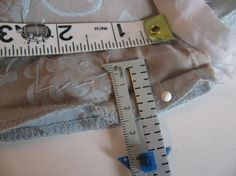 Altering side of lined dress, can be applied to blazer.