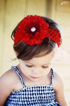 red hair flower on sweet little girl