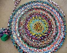 Braided T shirt yarn rug.  This probably would take forever, but man is it cool!