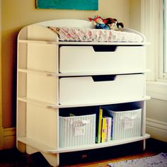 Baby changing table with lots of storage.