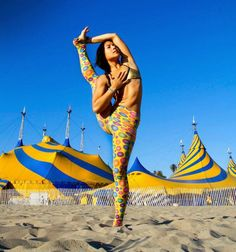 yoga pose in front of Cirque du Soleil