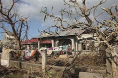 Clothes are dried on fallen power lines in Daanbantayan town, the northernmost town of Cebu province, Philippines Sunday, Nov. 10, 2013, two days after the Typhoon Haiyan hit Philippines. Rescuers faced blocked roads and damaged airports on Monday as they raced to deliver desperately needed tents, food and medicines to the typhoon-devastated eastern Philippines where thousands are believed dead. (AP Photo/Aledel Cuizon)
