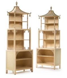 REGENCY STYLE CREAM AND GREEN PAINTED PAGODA-FORM STANDING BOOKCASES