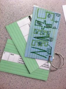 Students use index cards to track their own IEP goals.