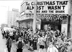 History Corner: A Look Back (December 2008) : Gallery  Lincoln Theater.jpg      1966: About 1,000 children attended the Lincoln Theater on a Saturday. The children were guests of the Millikin National Bank, which sponsored a Christmas party. The Ambassador Hotel, visible in the background, opened in 1965. (H File Photo)