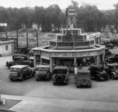 (ca. 1930)^ - Automobiles parked around Carpenter's Sandwich Drive-in restaurant located on the corner of Sunset and Vine.	        Historical Notes    Carpenter's Sandwiches drive-in was located at 6285 Sunset Boulevard between Vine Street and Argyle in Hollywood. For 30 cents you could enjoy a hamburger and wash it down with a cup of beer while sitting behind the wheel of your car (5 cents more for the premium beer).