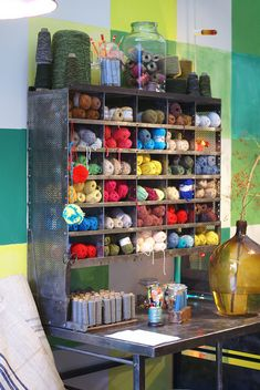 Old industrial shelving unit re-purposed for a wonderful yarn storage space that looks great//craft room