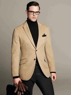 Camel blazer with black pants and turtleneck.