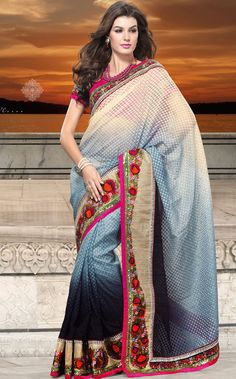 Era with extension in fashion, style, Grace and elegance have developed grand love affair with this ethnical wear.   This light cream, grey and black net saree is nicely designed with embroidered patch work is done with resham, zari, sequins and stone work.   Beautiful embroidery work on saree make attractive to impress all.   This saree gives you a modern and different look in fabulous style.   Contrasting dark pink blouse is available.