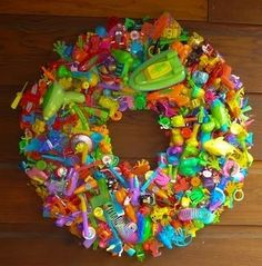 A wreath made completely out of dollar toy packs. Cute for a play room!