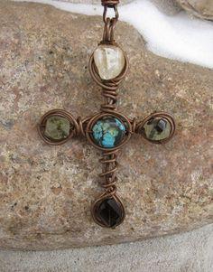 Cross wire pendant.