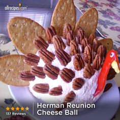 Herman Reunion Cheese Ball | Get creative with this cheese ball. Pecans for the feathers, crackers for the tail feathers, and a red bell pepper strip for the neck and head.