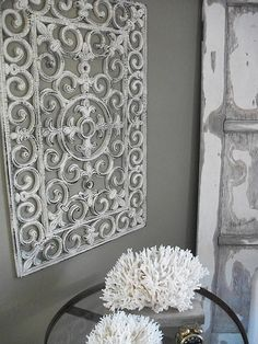 For an expensive-looking wall panel at a fraction of the cost, try buying a dollar store outdoor black rubber door mat and spray paint with Heirloom White from Home Depot. Sand to get a rustic feel.