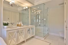 Another great idea to make a small bathroom feel larger -> Replace cabinet panels with mirrors and add a bit of small moulding! An extra large mirror and pretty scones complete the look!!  Be sure to install a VERY LARGE mirror in the bathroom. Also, separate the shower/bathing area with clear glass door and walls, again, very important to give a sense of space.