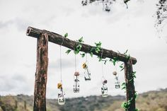 These suspended vases on a arbor would make a nice photo backdrop