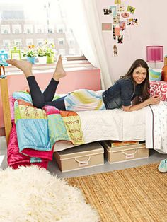 Under-bed storage containers save space in a small dorm room.