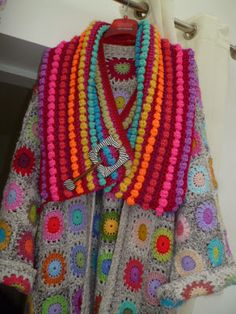 Bold crochet neck wrap over motif jacket. Love it.