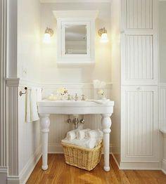 Storage Basket While Pedestal Sinks Offer Distinction