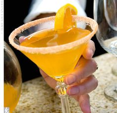 Tangerini    1 oz tangerine schnapps  1 oz vodka  tangerine juice  orange peal for garnish    Can make orange colored sugar by adding food coloring and mixing...for rim. Shake and strain first 3 ingredients into chilled glass, garnish with orange peel.