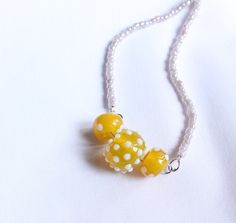 Dottie (yellow lampwork beads with white dots, gemstone, bead necklace) on Etsy, $2.20