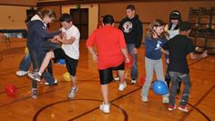 balloon stomp-every team members has a balloon tied to their leg (different color per team) then each team attempts to pop all of the balloons of the other team first