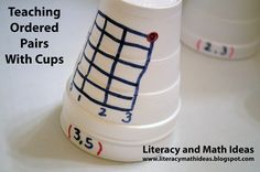 Teach ordered pairs with cups.  Helpful teaching ideas.