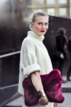 a giant knit, fur clutch and stained lips