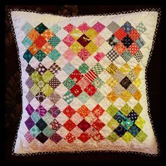 """Granny square mini from last year finally done! Quilted it, Made it a pillow and washed it to make it fit the pillow form I had. I love it! About 19"""" finished and washed., via Flickr."""