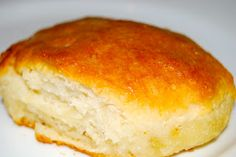 7UP Biscuits ~   2 c Bisquick mix 1/2 c sour cream 1/2 c 7up 1/4 c melted butter Preheat oven to 450º