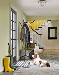 The stone floor of this New Hampshire home's entryway welcomes muddy feet and paws.
