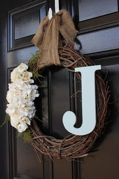 Customized Wreath. Love the wreath and i think my next front door will be black.