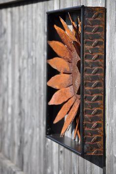 Metal Garden Art, Metal Flower, sculptured metal sunflower wall art with natural rust finish. $59.00, via Etsy.