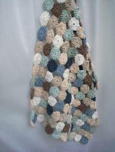 Crochet yo-yos blanket.
