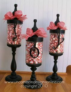 Crafty Apothecary jars: Option. Reuse peanut butter jar & paint the lid black. Candlestick from $1 store-paint black, heavy duty glue, red striped ribbon, peppermint button candies. ADORABLE! apothecary jars, season, christmas decorations, christma decor, candies, christmas candy, holidays, candy jars, the holiday
