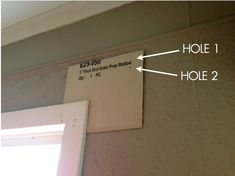 how to hang drapery rods (curtain rods) without measuring or using a level! SO easy!...
