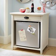mini fridge storage space. could be used as a nightstand.