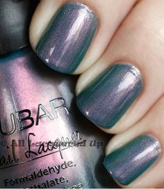 Nubar Indigo Illusion. Swatch from All Lacquered Up. A cool purple grey duochrome with fine violet pink shimmer that shifts to blue and green.