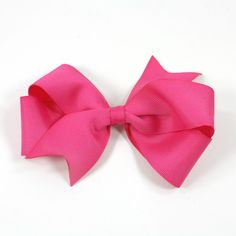 "Today's tutorial is on how to make a boutique bow. I used to be pretty intimidated by these bows. I thought they looked hard, but they are actually pretty darn easy, so I'm excited to share that with you today! You will need: About a 30"" Length of 1.5"" Grosgrain Ribbon A Small Scrap of 3/8"""